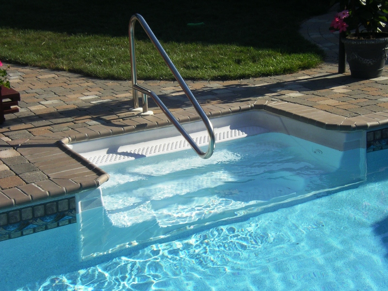 ... Pool With 8u0027 Polymer Cantilever Sit N Step With Pavers For Coping, And  New Vinyl Liner. Handrail Is A U201cdip To Pool U201cstyle. Liner Pattern:  Canyon/Crystal