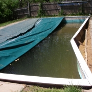 "BEFORE - Wall collapse on steel wall pool with 8"" aluminum coping (due to age and insufficient water lever over the winter)."