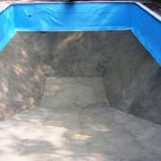 AFTER - New vermiculite bottom a few pieces of sheet metal patch, and wall foam and this pool is ready for a new vinyl liner.