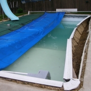 "BEFORE - Wall collapse on Fiberglass wall (Dream Pool) with 8"" aluminum coping."