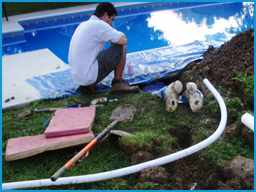 APCO personnel replacing a plumbing line without the removal of any concrete decking.